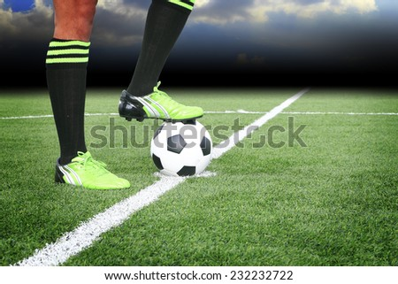 Soccer ball on field in stadium - stock photo