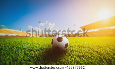 Soccer ball on grass in soccer stadium.  - stock photo