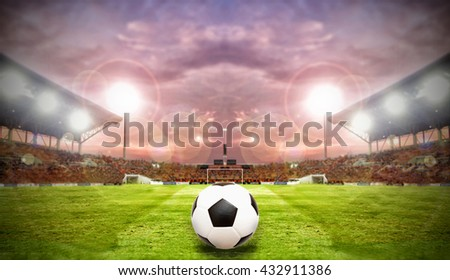 Soccer Ball On Green Field of football stadium for background  - stock photo
