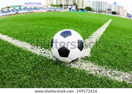soccer ball on green grass field - stock photo