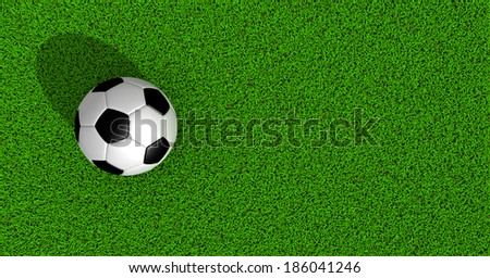 soccer ball on green grass, top view