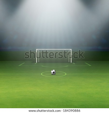 Soccer ball on green stadium, arena in night illuminated bright spotlights, soccer goal - stock photo