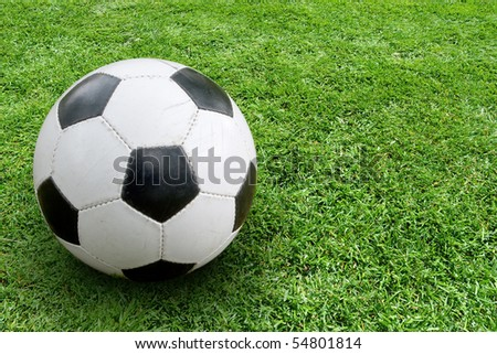 Soccer ball on ground. In the right part of the image space for text - stock photo