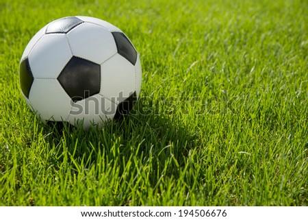 soccer ball on soccer field - stock photo