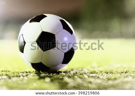 Soccer ball on sports field - stock photo
