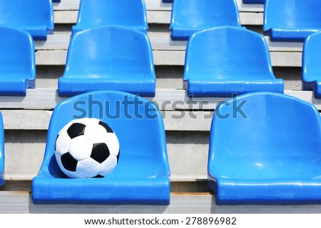 Soccer ball on stadium seat - stock photo