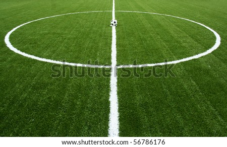 soccer ball on start kick of game - stock photo