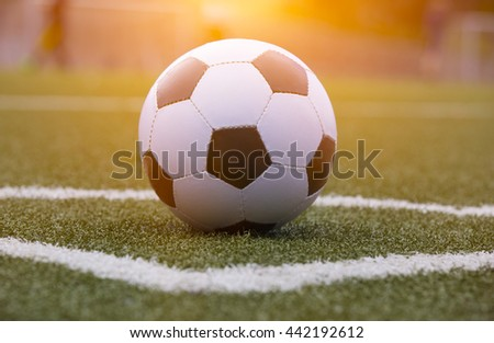 Soccer ball on the field with morninglight - stock photo