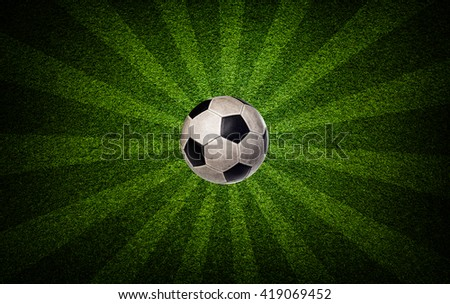 Soccer ball on the field with radial rays background - stock photo