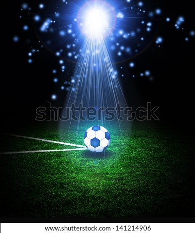 Soccer ball on the green field with lightnings - stock photo