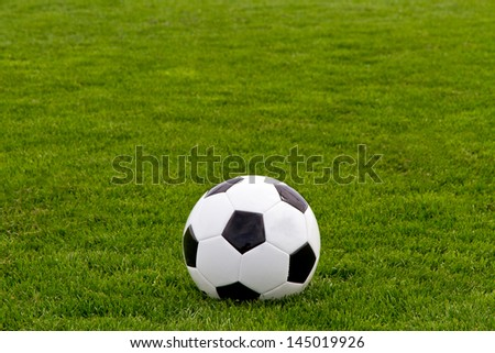 Soccer ball on turf - stock photo