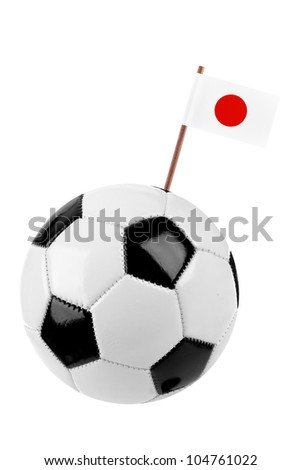 Soccer ball or football decorated with a small national flag of Japan  on a tooth stick - stock photo