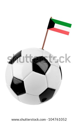 Soccer ball or football decorated with a small national flag of Kuwait  on a tooth stick - stock photo