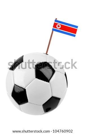 Soccer ball or football decorated with a small national flag of North Korea on a tooth stick - stock photo