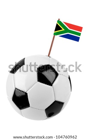 Soccer ball or football decorated with a small national flag of South Africa on a tooth stick - stock photo