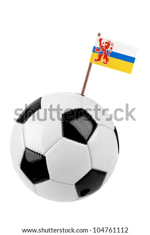 Soccer ball or football decorated with a small provincial flag of Limburg  on a tooth stick - stock photo