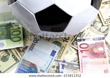 soccer ball over a lot of money - stock photo