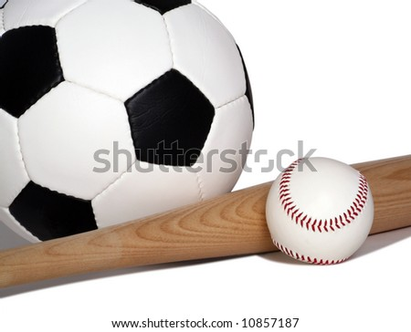 Soccer ball pictured with Baseball bat and ball - stock photo