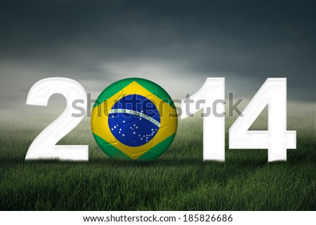 Soccer ball with brazilian flag on the field symbolizing soccer championship of 2014 - stock photo
