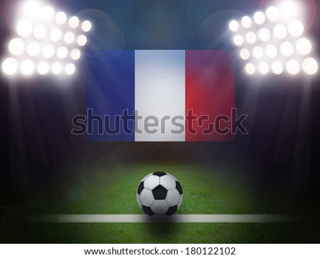 Soccer Ball with France Flag,bright spotlights. - stock photo