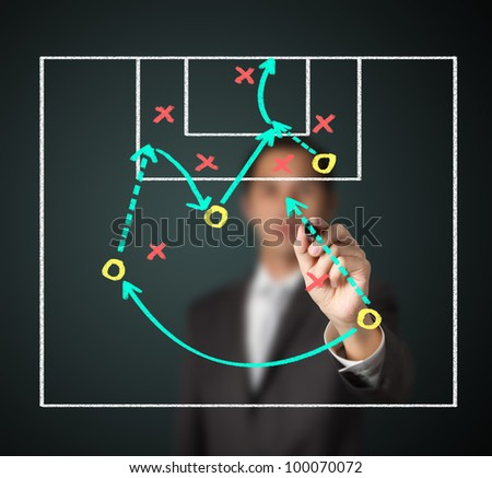 soccer coach writing strategy of attacking game - stock photo