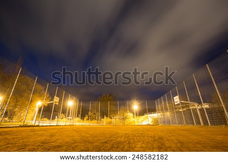 soccer court cage at night  - stock photo