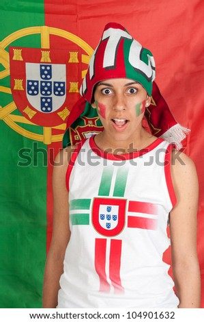 Soccer fan with a portuguese scarf and a surprise face - stock photo