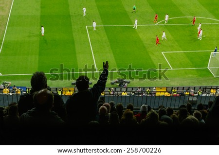 Soccer fans in a match. Spectators complaint about a bad decision of the referee - stock photo