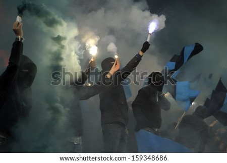 Soccer fans with fireworks - stock photo
