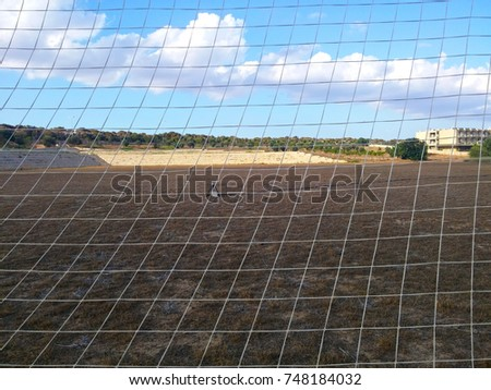 Soccer field and goal net.