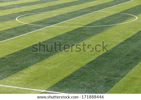 Soccer field background under the sun - stock photo