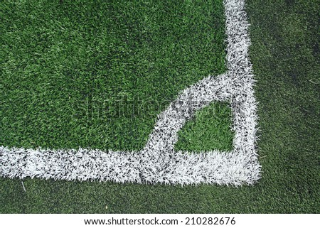 Soccer field grass at the corner - stock photo