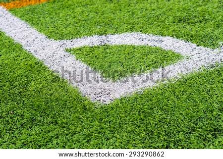 Soccer field grass corner,Green artificial grass - stock photo