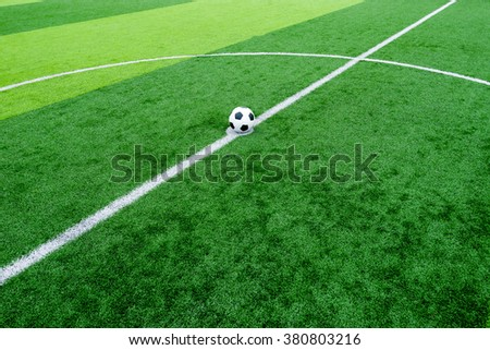 soccer field grass with ball at kick off point - stock photo