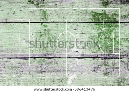 Soccer field lines on a Wood surface background texture