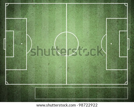 soccer field on grunge board. - stock photo
