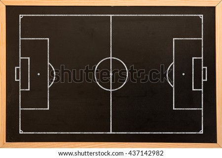 Soccer field plan against blackboard with copy space