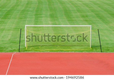 Soccer field with gate and yellow net