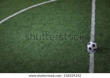 Soccer field with soccer ball on the line - stock photo