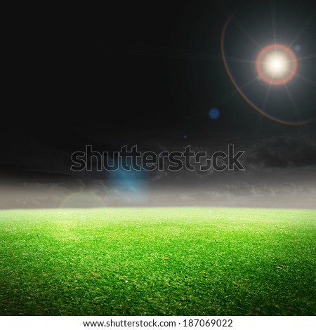 soccer field with the bright projectors - stock photo