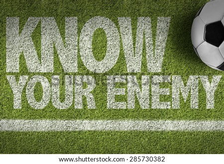 Soccer field with the text: Know your Enemy - stock photo