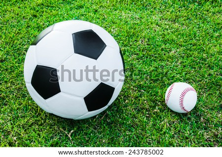 Soccer Football and Baseball Ball on Grass Field with Natural Light (in Stadium or Local Field) Sport Concept and Idea / for background, wallpaper, texture. Standard Ball.