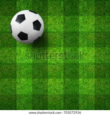 Soccer football ball on green grass pattern and texture background.