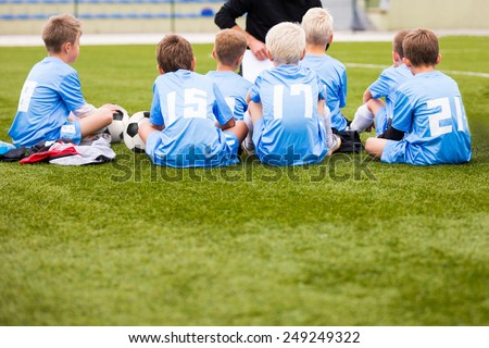 soccer football coach tactic strategy speech. kids listening coach strategy speech. - stock photo