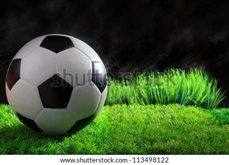 soccer football on green grass field - stock photo