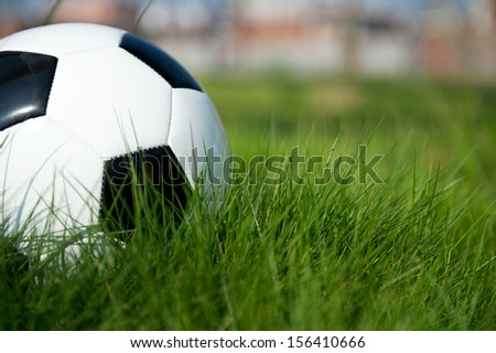 Soccer football on the green grass. - stock photo