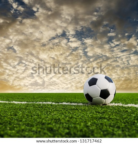 Soccer Football on the Green Grass Texture in Soccer Field with Sky. - stock photo