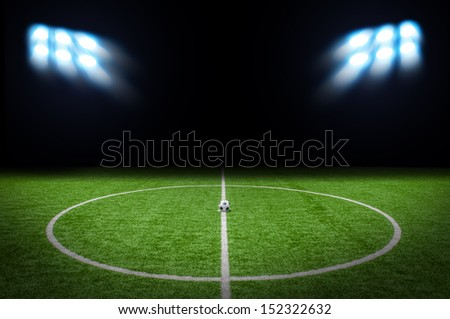 Soccer Football on the Green with bright spotlights - stock photo