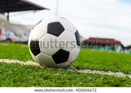 Soccer Football on white line of Soccer field. - stock photo
