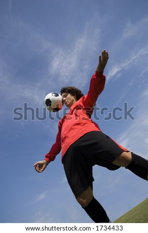 Soccer - Football Player controlling ball - stock photo